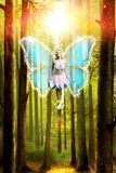 Fairy with magic in front of an enchanted forest Royalty Free Stock Photo