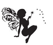 Fairy with a magic wand. Silhouette of the fairy with wings and a magic wand Royalty Free Stock Photos