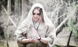 Fairy magician. A sorcerer with a glass sphere, a magical spell Stock Photography
