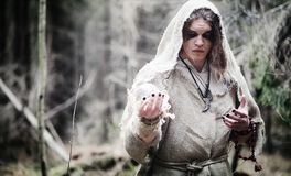 Fairy magician. A sorcerer with a glass sphere, a magical spell Stock Photo
