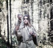 Fairy magician. A sorcerer with a glass sphere, a magical spell Royalty Free Stock Photo