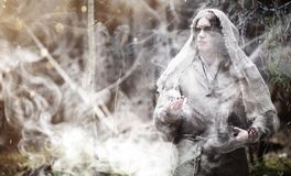 Fairy magician. A sorcerer with a glass sphere, a magical spell Royalty Free Stock Images