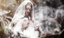 Fairy magician. A sorcerer with a glass sphere, a magical spell Royalty Free Stock Photos
