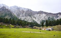 Fairy Meadows Cottages. Fairy Meadows is reachable by a twelve kilometer-long jeepable trek starting from Raikot bridge on Karakoram Highway to the village Tato stock photo