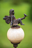 Fairy metal statue. Garden decoration with a metal statue of a fairy Stock Photos