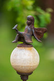 Fairy metal statue. Garden decoration with a metal statue of a fairy Stock Photo