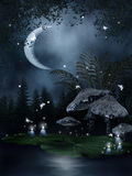 Fairy mushrooms by the water Royalty Free Stock Image
