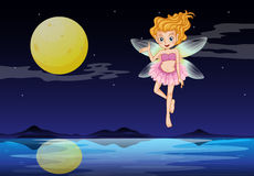 A fairy near the moon Stock Photo