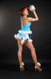 Fairy playing christmas ball on dark background Royalty Free Stock Photos