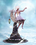 Stars Fairy. The fairy playing with the light of the stars! The fairy sitting on a moon statue.  The moon statue stands in the sea Royalty Free Stock Images