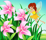 A fairy pointing the pink flowers at the garden Royalty Free Stock Image