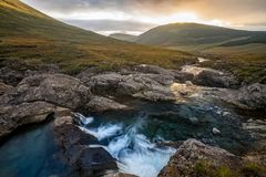 Fairy Pools, Isle of Skye. A waterfall cascade at the Fairy Pools with the Cuillin mountains Royalty Free Stock Photos