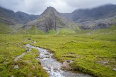 The famous Fairy Pools with the Black Cuillin Mountains in the background, Isle of Skye, Scotland. stock photo