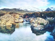 Fairy pools with waterfall. The river bellow majestatic Glen Brittle. The Fairy pools with waterfall. The river bellow majestatic Glen Brittle mountain, popular stock photos