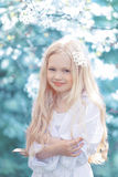 Fairy portrait young girl. Teen in spring garden. Spring day, blooming cherry tree Royalty Free Stock Photos