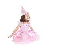 Fairy princess. Young girl dressed as fairy princess sitting isolated on white royalty free stock images