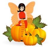 Fairy on a pumpkin Royalty Free Stock Photo