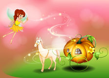 A fairy and a pumpkin cart Royalty Free Stock Photography