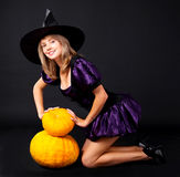 Fairy with pumpkins Stock Image