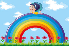 Fairy relaxing on colorful rainbow Stock Image