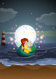 A fairy riding on a boat at the beach Royalty Free Stock Photography