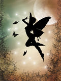 Fairy silhouette. In a forest with big moon Royalty Free Stock Images