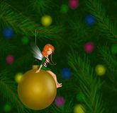 Fairy Sitting on a Christmas Tree Ornament. Female fairy in a Christmas tree sitting on a ornament Stock Photos