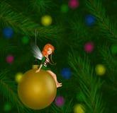Fairy Sitting on a Christmas Tree Ornament Stock Photos