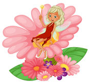 A fairy sitting on a pink flower Royalty Free Stock Images