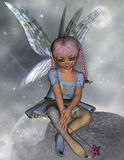 Fairy sitting on a rock with star wand. A 3D rendered image of a cute fairy girl with a blue dress and star wand in her hand. Ideal for design projects Royalty Free Stock Photo