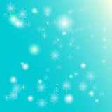 Fairy snowflakes winter background. Randomly placed magical snowflakes on light blue background remind you about magic of Winter days Royalty Free Stock Photography