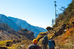 Fairy Spring Mountain Landscape and rear View of Hikers walking Royalty Free Stock Photography