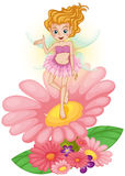 A fairy standing above the flower Royalty Free Stock Photos