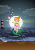 A fairy standing on a boat at the beach Royalty Free Stock Photography