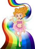 A fairy standing at the rainbow Royalty Free Stock Photography