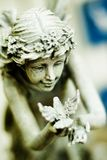 Fairy statue. Statue of fairy holding a bird Royalty Free Stock Image