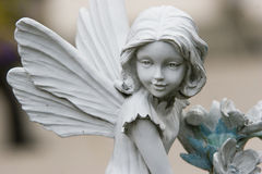 Fairy statue. Statue of fairy against a blurry background Royalty Free Stock Photography