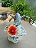Fairy Statue. With flower sitting on base Stock Photo