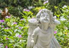 Fairy Statue in the garden with flower. Fairy Statue in public garden with flower Royalty Free Stock Image
