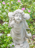 Fairy Statue in the garden with flower. Fairy Statue in public garden with flower Stock Images