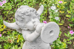 Fairy Statue in the garden with flower Royalty Free Stock Photography