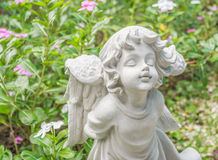 Fairy Statue in the garden with flower. Fairy Statue in public garden with flower Stock Image