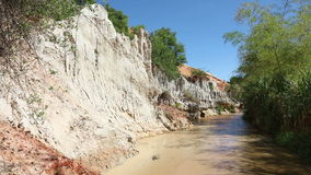 Fairy Stream Canyon. Red river between rocks and jungle. Mui Ne. Vietnam stock video
