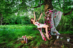 Fairy swinging on teeterboard Royalty Free Stock Photography