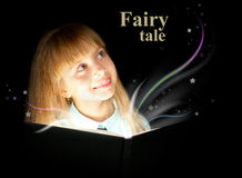Fairy tale. The kid reading a book of fairy tales Stock Photo