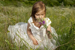 Fairy-tale beautiful little girl on a lawn Royalty Free Stock Images