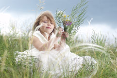 Fairy-tale beautiful little girl on a lawn Royalty Free Stock Photography