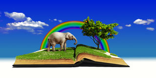 Fairy tale book. Open book with elephant on the grass. illustration .concept Stock Photos