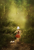 Fairy tale is calling ... The little girl on the road to fairy tale.Children's dreams come true Royalty Free Stock Image