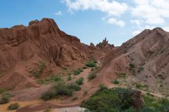Fairy Tale Canyon. Also Skazka, rock formations on the Issyk-Kul lake, Kyrgyzstan Stock Photos